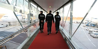 Three-French-police-at-an-airport-320x160